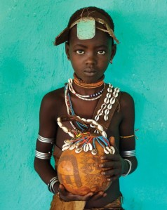 "Photo by Alison Wright  ""Duka from Hamer tribe holding a gourd, Omo Valley, Ethiopia, 2006"""
