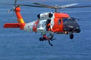 An HH-60 Jayhawk helicopter crew from Coast Guard Air Station Astoria, Ore., conduct a search and rescue demonstration in Elliott Bay near downtown Seattle. USCG photo by PA3 Adam Eggers