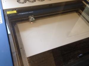 Laser cutting through acrylic like butter. 50W Epilog Helix laser cutter.