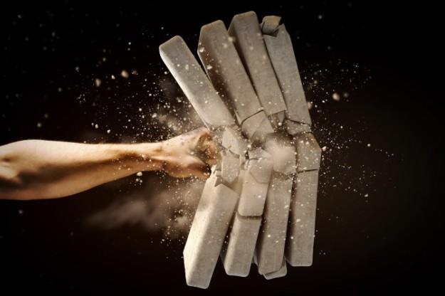 bigstock-Close-up-of-human-hand-breakin-53372011-672x448