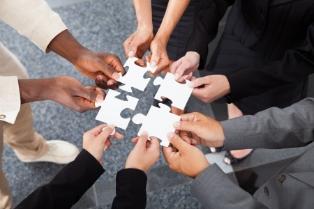 Teamwork-5-people-holding-puzzle-pieces.jpg